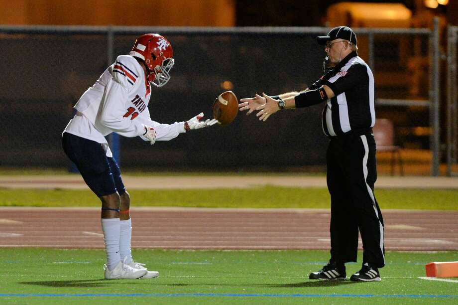 Shea Whiting (11) of Taylor hands the ball to an Official after his touchdown reception in the second quarter of a high school football game between the Alief Taylor Lions and the Hastings Bears on October 27, 2017 at Crump Stadium, Houston, TX. Photo: Craig Moseley/Houston Chronicle