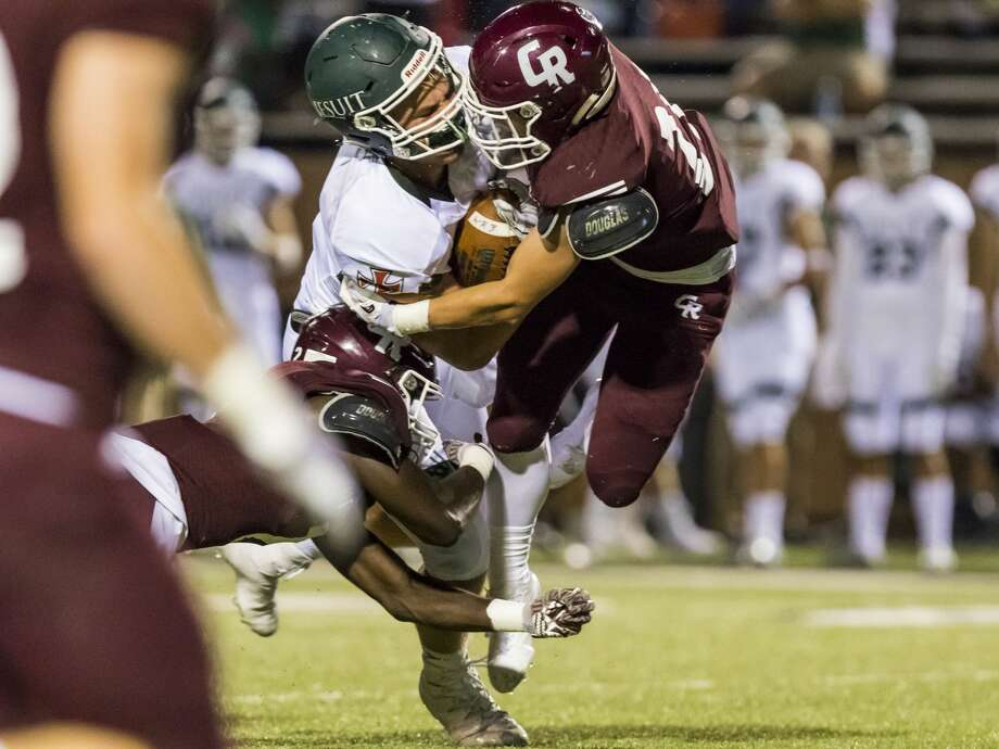 Strake Jesuit wide receiver Thomas Gordon (87) is tackled by Cinco Ranch defensive back Jamie Wolfe (21) in a high school football game at Rhodes Stadium on Friday, Sept. 29, 2017, in Katy, Texas. (Joe Buvid / For the Houston Chronicle) Photo: Joe Buvid/For The Houston Chronicle