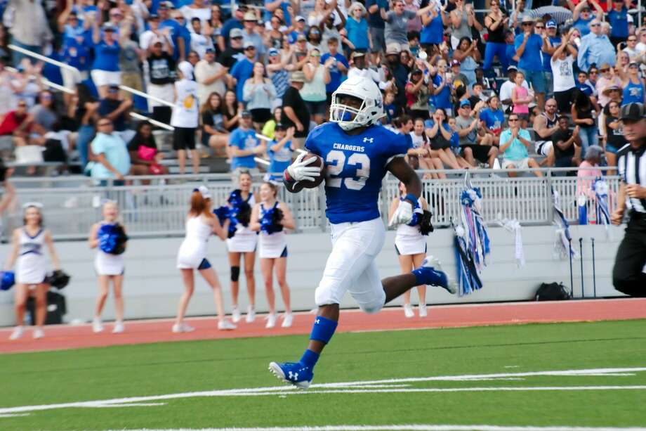 Clear Springs' Todd Hudson (23) sprints down the sideline for a touchdown against Dickinson Saturday, Oct. 14 at CCISD Challenger Columbia Stadium. Photo: Kirk Sides/Houston Chronicle