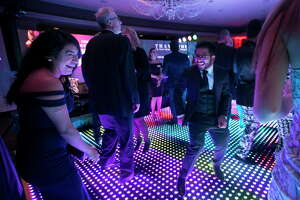 Guests enjoy a lighted dance floor during the Greater Houston Partnership's 2018 Houston Through the Looking Glass soirée on Saturday, Aug. 25, 2018, in downtown Houston.