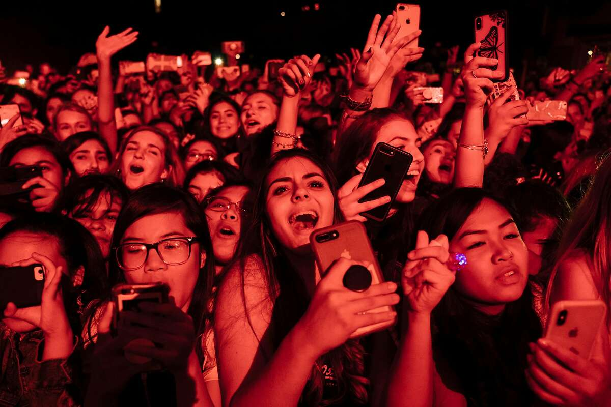 Conferences, seated live events, sports and indoor concerts - such as this Calpurnia performance at the Fillmore in 2018 - can resume, starting April 15, state officials said.