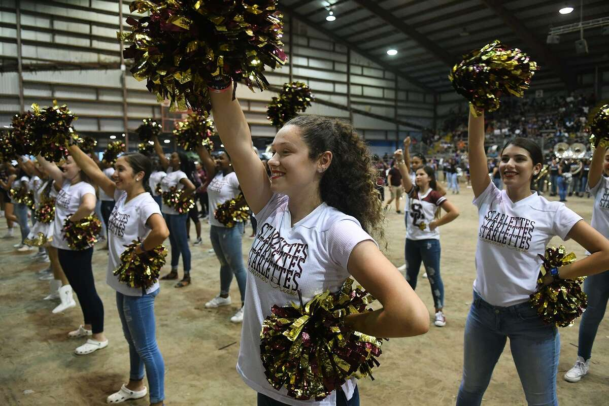 Grace Bocca, center, a Summer Creek High School senior, leads the SCHS Starlettes during their performance at the Humble ISD Pep Rally for the community kicking off the district's Centennial Year Celebration in the arena at the Humble Civic Center on August 25, 2018.
