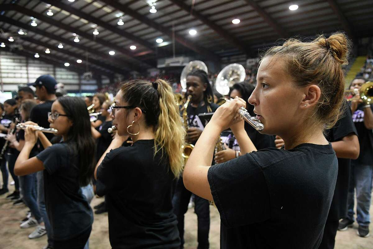 Ana Davis, 17, right, a Humble High School senior, and the HHS Wildcat Band performs during the Humble ISD Pep Rally for the community kicking off the district's Centennial Year Celebration in the arena at the Humble Civic Center on August 25, 2018.