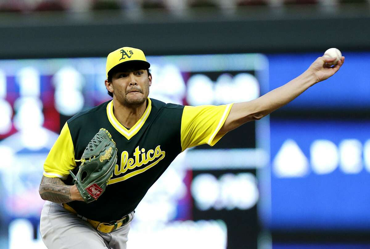 Oakland Athletics pitcher Sean Manaea throws to a Minnesota Twins batter during the first inning of a baseball game Friday, Aug. 24, 2018 in Minneapolis. The Athletics defeated the Twins 7-1. (AP Photo/Andy Clayton-King)