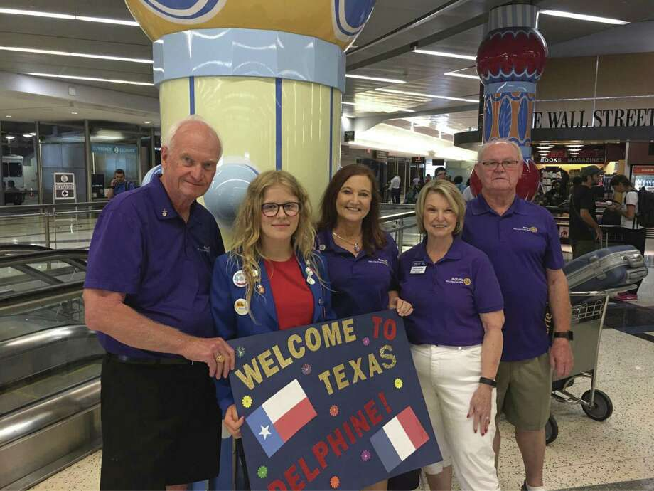 Delphine, Rotary Youth Exchange Student from Normandy, France, is greeted at the airport by her first host family Gary and Janet Milleson, and Rotary Youth Exchange committee members Doris and Wally Lockey.