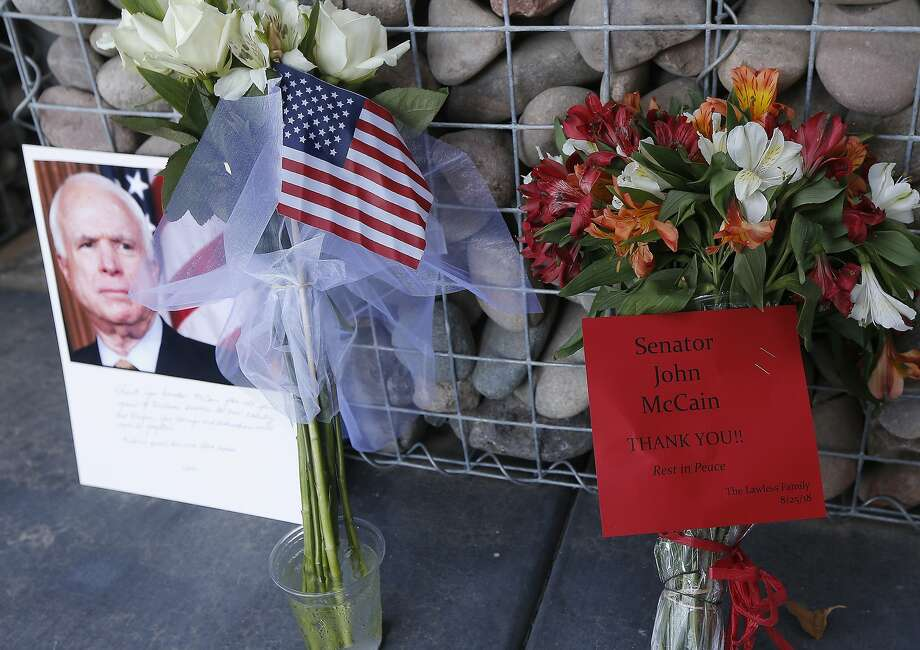 A memorial grows at the Phoenix office of Sen. John McCain, who died Saturday at 81. Photo: Ross D. Franklin / Associated Press