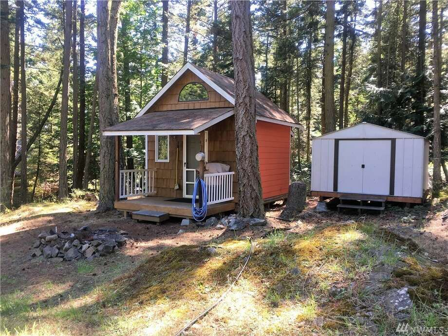 248-square-feet cabin with a loft bedroom and water views. Plus, a building site is prepped for your own custom home. 1060 Chinook Way, listed for $125,000. See the full listing below. Photo: Listed By Sarah Jones • Windermere RE Anacortes Prop.
