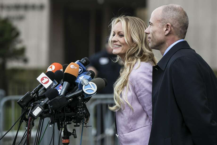 Stephanie Clifford, the porn star known as Stormy Daniels, speaks to reporters in April. Photo: Jeenah Moon / New York Times