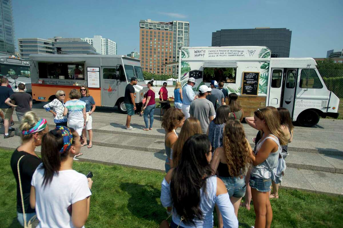 Food lovers wait in line at one of the more than two dozen food trucks at the second annual Hey Stamford! Food Fest in Mill River Park in downtown Stamford, Conn. on Sunday, Aug. 26, 2018.
