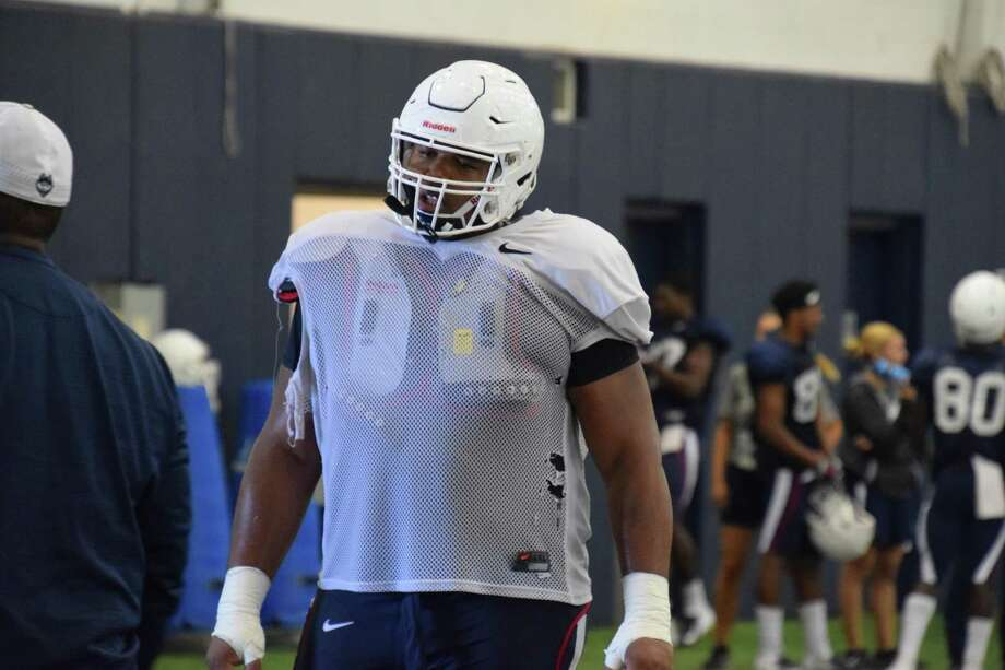 Freshman Travis Jones is listed as the starting nose tackle for UConn on its depth chart for the season opener. Photo: UConn Athletics