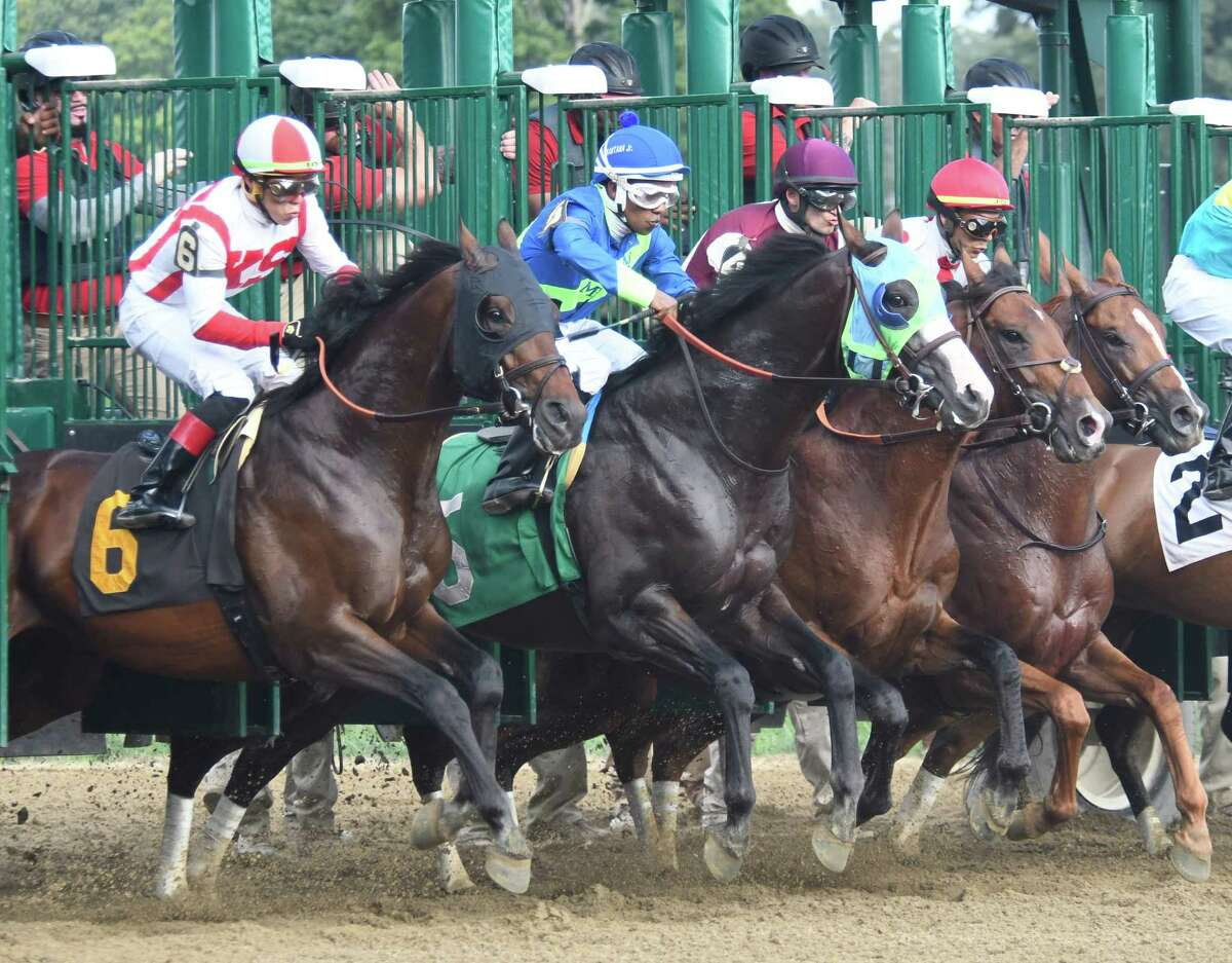 Horses and jockeys burst out of the gate at Saratoga Race Course in Saratoga Springs, N.Y. in 2018. (Jenn March, Special to the Times Union )