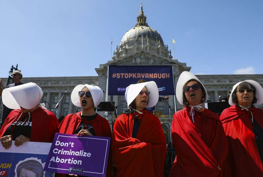 "Women in ""Handmaid's Tale"" costumes make a statement at the Unite for Justice rally in San Francisco. Photo: Photos By Gabrielle Lurie / The Chronicle / ONLINE_YES"