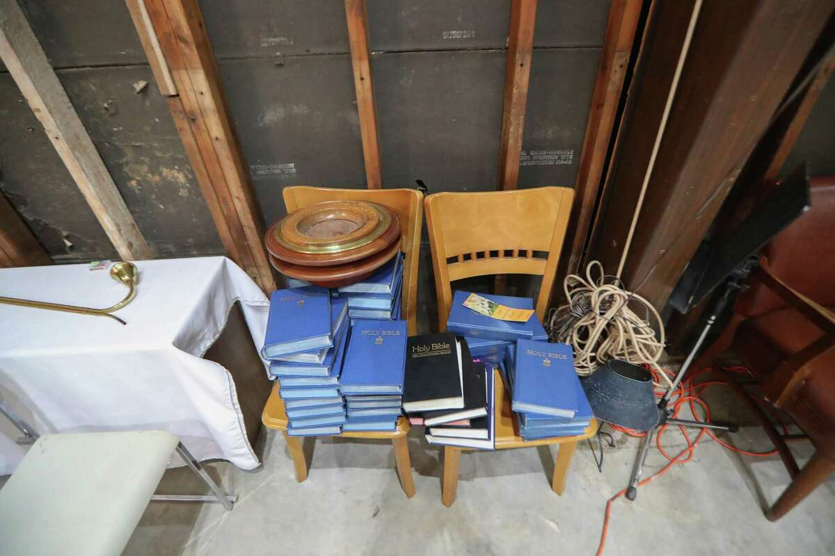 Holy Bibles are placed on two wooden chairs by walls stripped to the the studs in the First Presbyterian Church of Dickinson Sunday, Aug. 26, 2018, in Dickinson. It has been 52 weeks now, after the storm brought 5 feet of water into the church destroying the building - but not parishioners spirits.