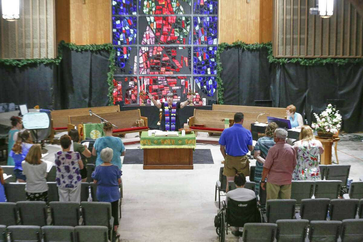 The Rev. Kathy Sebring held a worship service in the First Presbyterian Church of Dickinson Sunday, Aug. 26, 2018, in Dickinson. It has been 52 weeks now, after the storm brought 5 feet of water into the church destroying the building - but not parishioners spirits.
