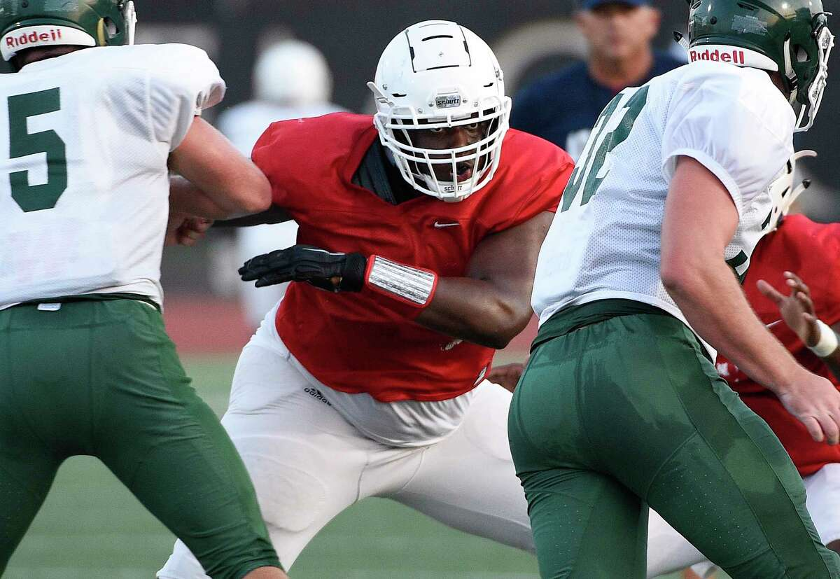 Atascocita offensive lineman Kenyon Green, center, blocks during a high school football scrimmage, Friday, August 24, 2018, in Humble, TX. (Eric Christian Smith/For the Chronicle)