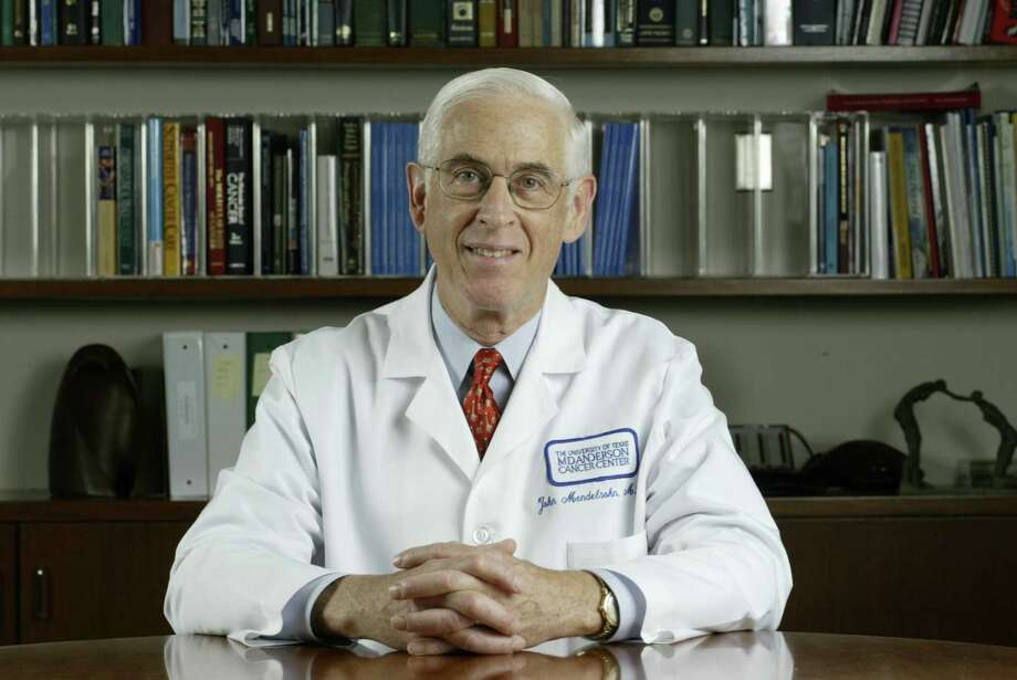 Dr. John Mendelsohn, president of M.D. Anderson Cancer Center from 1996 to 2011, posed for this portrait in his office in 2003. Mendelsohn, a top scientist and the architect behind MD Anderson's emergence as the world's top cancer center, died late Monday night of brain cancer. Photo: Buster Dean,  STAFF / HOUSTON CHRONICLE / HOUSTON CHRONICLE