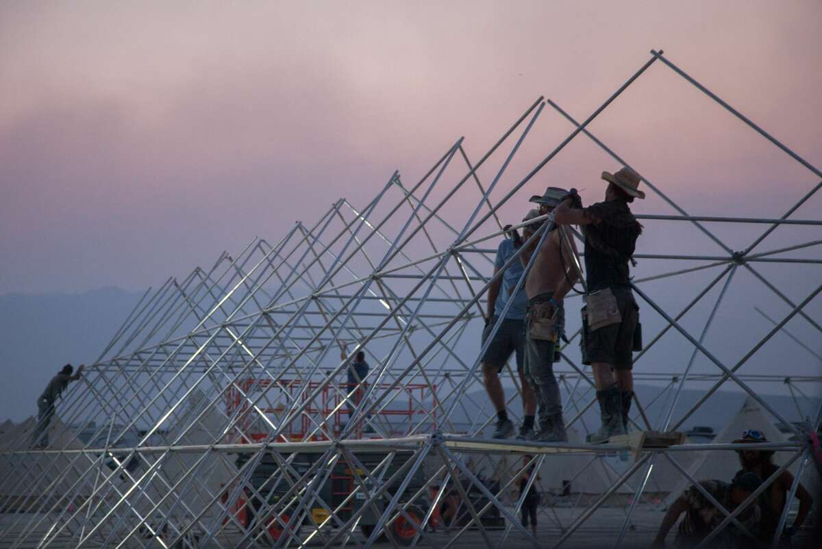 Early arrivals to Burning Man take part in