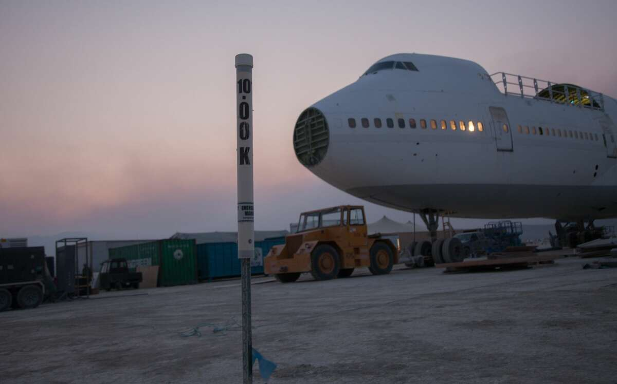 """Early arrivals to Burning Man take part in """"Build Week"""" ahead of the main event, showing some of the work, art setup and mutant cars that arrive on the playa before most attendees."""