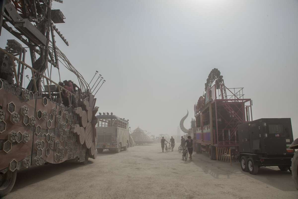 """Early arrivals to Burning Man take part in """"Build Week"""" ahead of the main event, showing some of the work, art setup and mutant cars that arrive on the playa before most attendees. Those attempting to enter the event on Sunday experienced major delays due to """"extreme weather."""""""