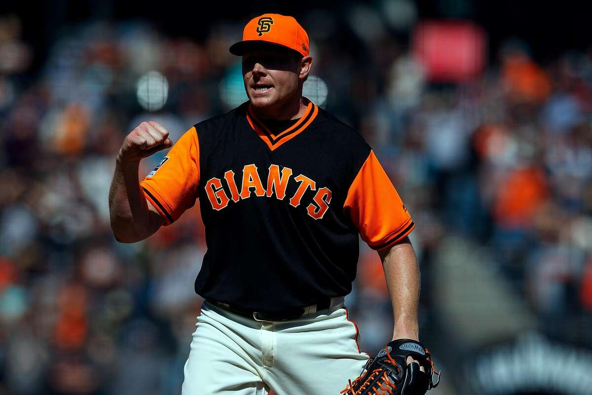 SAN FRANCISCO, CA - AUGUST 26: Mark Melancon #41 of the San Francisco Giants celebrates after the game against the Texas Rangers at AT&T Park on August 26, 2018 in San Francisco, California. The San Francisco Giants defeated the Texas Rangers 3-1. All players across MLB will wear nicknames on their backs as well as colorful, non-traditional uniforms featuring alternate designs inspired by youth-league uniforms during Players Weekend. (Photo by Jason O. Watson/Getty Images)