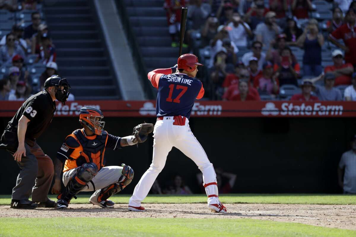 Los Angeles Angels' Shohei Ohtani (17) prepares to pinch-hit against the Houston Astros during the ninth inning of a baseball game Sunday, Aug. 26, 2018, in Anaheim, Calif. (AP Photo/Marcio Jose Sanchez)