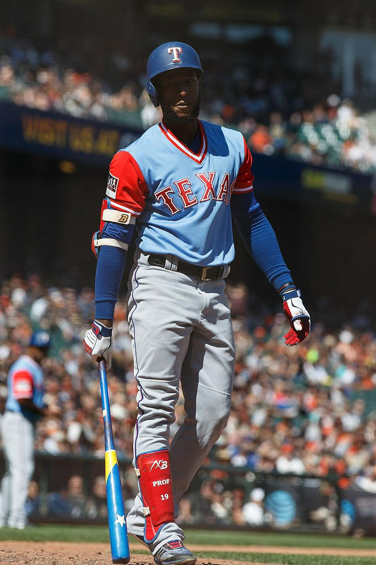 SAN FRANCISCO, CA - AUGUST 26: Jurickson Profar #19 of the Texas Rangers returns to the dugout after striking out against the San Francisco Giants during the eighth inning at AT&T Park on August 26, 2018 in San Francisco, California. All players across MLB will wear nicknames on their backs as well as colorful, non-traditional uniforms featuring alternate designs inspired by youth-league uniforms during Players Weekend. (Photo by Jason O. Watson/Getty Images)