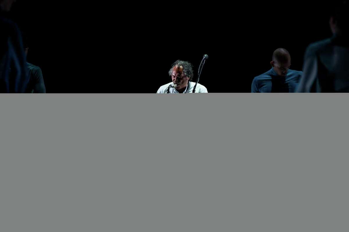 Saxophonist Richard Howell, center, in the world premiere of Mangaku at YBCA Theater in San Francisco. 23 August 2018. San Francisco, California, USA; Gregory Dawson dancers rehearse Mangaku at the Yerba Buena Center for the Arts Theater. Photo: John Hefti