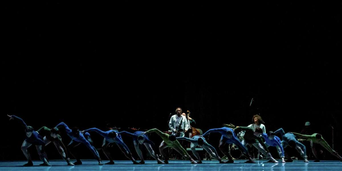 Dawsondancesf's full ensemble in the world premiere of Mangaku, with musicians illuminated from left, saxophonist Richard Howell, Ravi Abcarian on upright bass and Elé Salif Howell on drums. 23 August 2018. San Francisco, California, USA; Gregory Dawson dancers rehearse Mangaku at the Yerba Buena Center for the Arts Theater. Photo: John Hefti