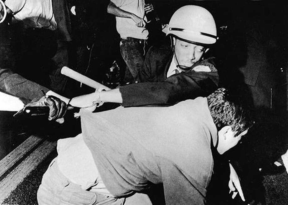 An officer from the Chicago Police Department struggles with an antiwar demonstrator outside Democratic headquarters at the Hilton Hotel on Michigan Avenue as demonstrators attempt to break through police lines to move the protest to the 1968 Democratic National Convention, being held five miles away at the International Amphitheatre, Chicago on Aug. 28, 1968. APA | Getty Images