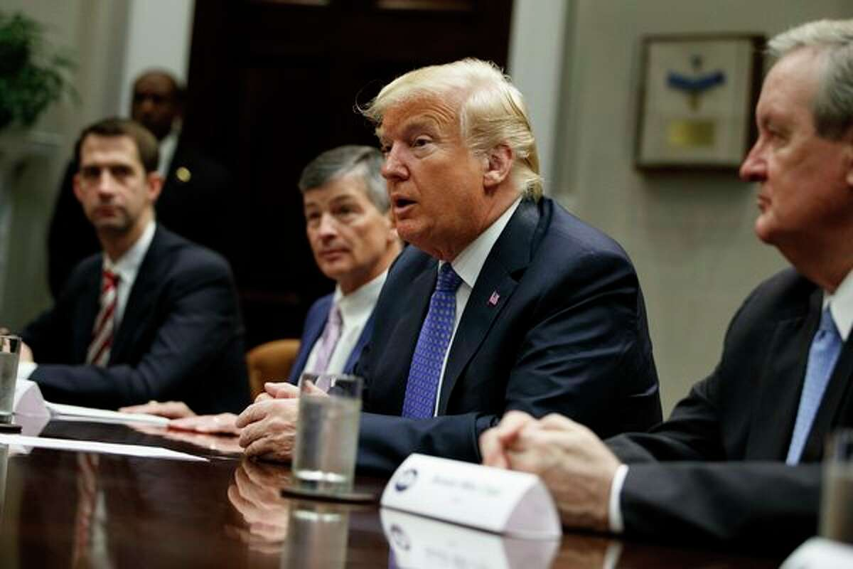 FILE - President Donald Trump speaks during a roundtable on the 'Foreign Investment Risk Review Modernization Act' in the Roosevelt Room of the White House, Thursday, Aug. 23, 2018, in Washington. From left, Sen. Tom Cotton, R-Ark., Rep. Jeb Hensarling, R- Texas, Trump, and Sen. Mike Crapo, R- Idaho. (AP Photo/Evan Vucci)