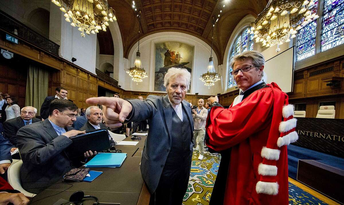 Mohsen Mohebi, representative of Iran, is pictured during the opening of case between Iran and the United States at the The International Court of Justice (ICJ) in the Hague, August 27, 2018. - Iran opened a lawsuit demanding the UN's top court order the suspension of renewed US sanctions which it says are devastating its economy. (Photo by Jerry Lampen / ANP / AFP) / Netherlands OUTJERRY LAMPEN/AFP/Getty Images
