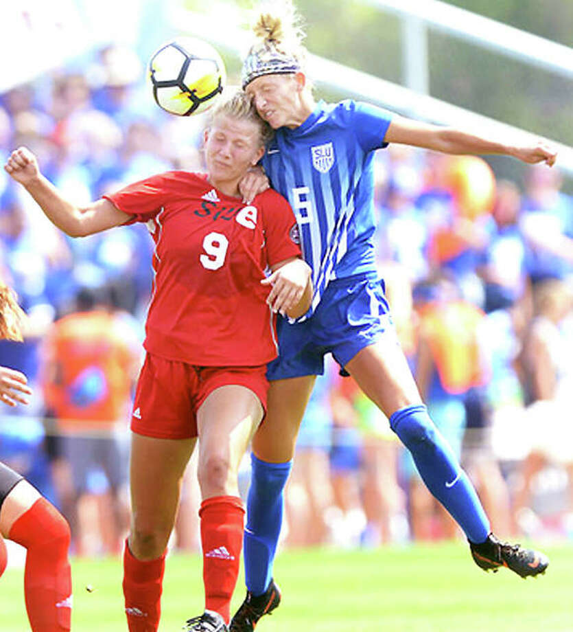 SIUE's Kayla Klipsch (9) and Saint Louis University's Courtney Reimer collide going for a headball during Sunday's game at Hermann Stadium. SLU won 4-0. Photo: Saint Louis Athletics