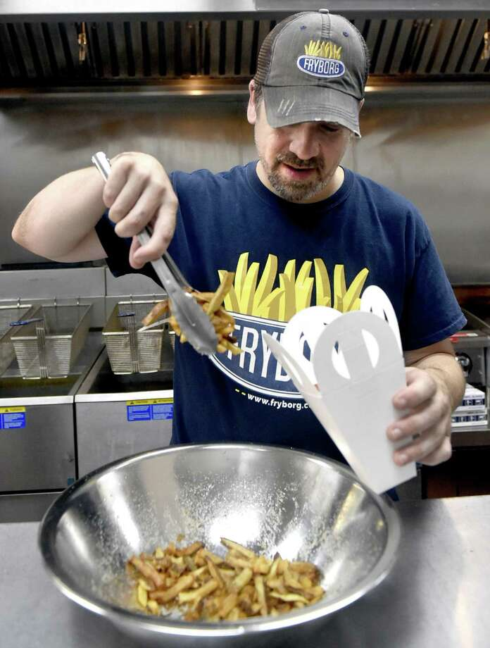 Jonathan Gibbons, owner of Fryborg, an eclectic Milford eatery featuring hand-cut french fries. Photo: Peter Hvizdak / Hearst Connecticut Media / New Haven Register