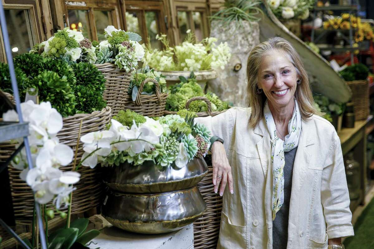 Kuhl-Linscomb owner Pam Kuhl-Linscomb stands in the faux flower department at her store Wednesday Aug. 22, 2018 in Houston.