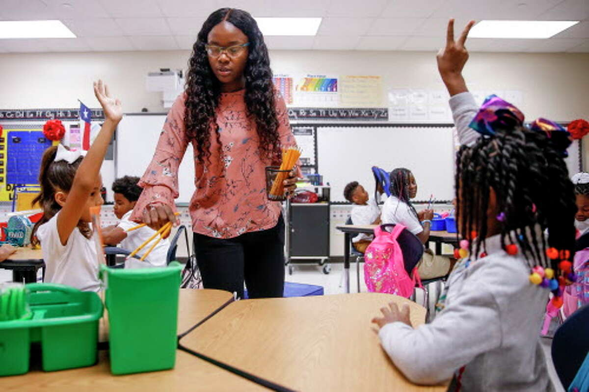 PHOTOS: Back to school Third grade teacher Bianca Fray passes out pencils to her students up as kids return to Hilliard Elementary School for the first time since Hurricane Harvey for the first day of school Monday Aug. 27, 2018 in Houston. The school underwent $5 million in repairs after the hurricane filled the school with more than four feet of water. >>See more photos of Hilliard's first day...