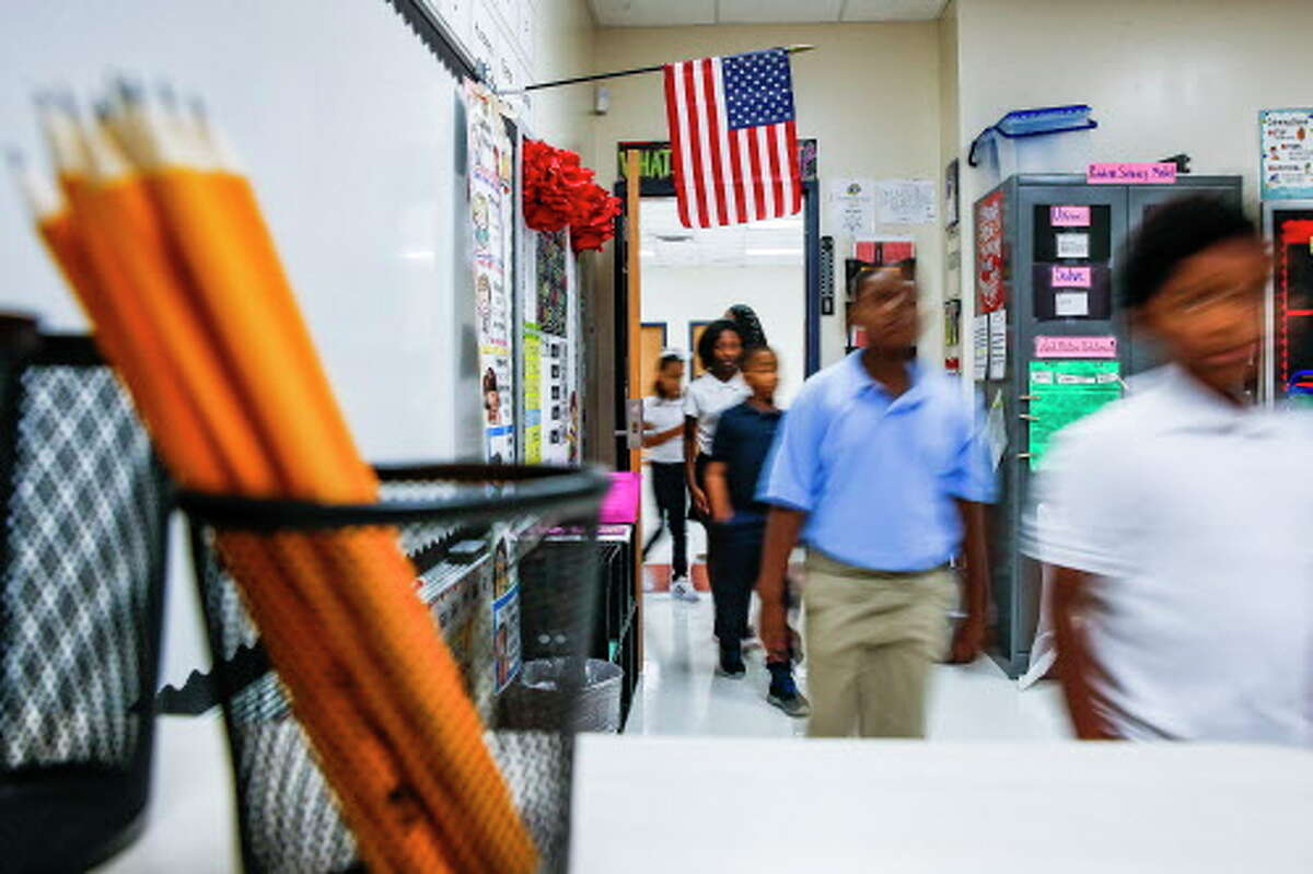 Hilliard Elementary School third grade students walk into their classroom during the first day of school as they return to the school for the first time since Hurricane Harvey Monday Aug. 27, 2018 in Houston. The school underwent $5 million in repairs after the hurricane filled the school with more than four feet of water.