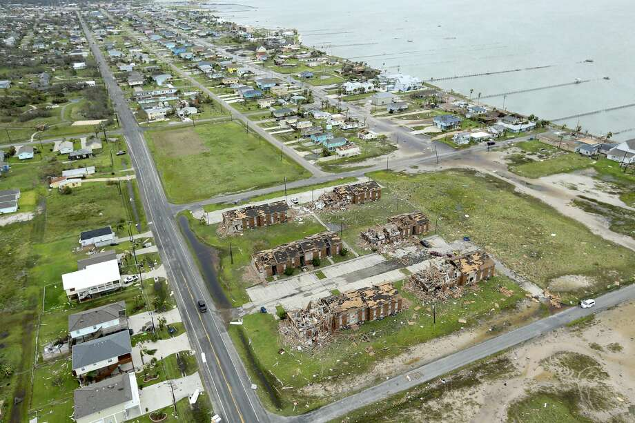 A storm damaged apartment complex in Rockport, Texas is seen in the foreground this Sunday, August 25, 2017. Aerial view while storm houses can be seen damaged in the background. Hurricane Harvey landed late in the night in Rockport as a Category 4 storm. Photo: William Luther / San Antonio Express News