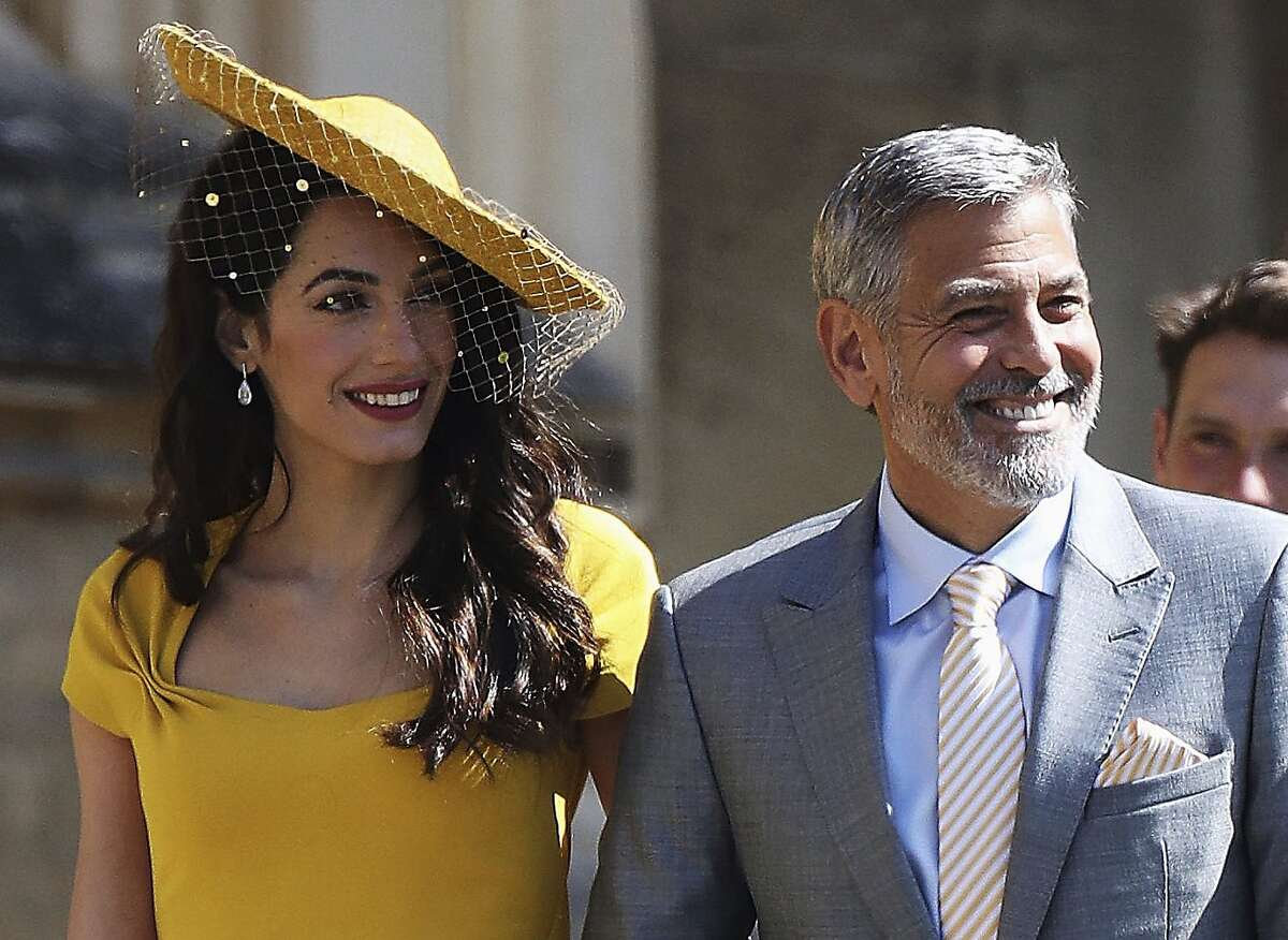 $27,283 per hour - George Clooney, shown with wife, Amal, at the royal wedding.