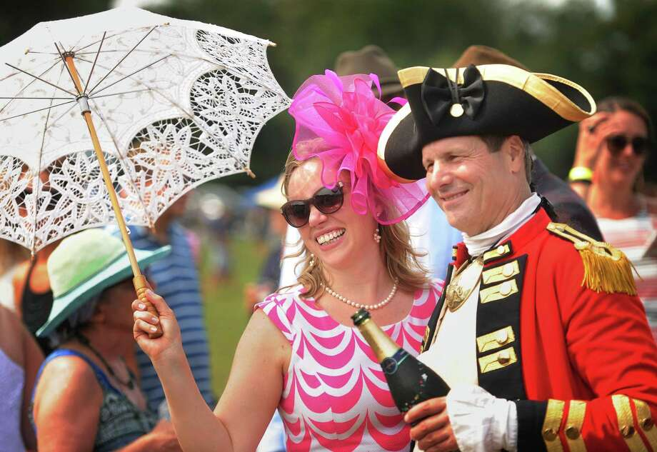 Rachel Bode, of New York City, poses for a photo with Dave Loda, of Bolton, dressed as British Revolutionary War General Sir William Howe, during halftime of a charity polo match at The Fairfield County Hunt Club in Westport, Conn. on Sunday, August 26, 2018. Proceeds from the event benefit the Bridgeport Hospital Foundation's REACH Program. Photo: Brian A. Pounds / Hearst Connecticut Media / Connecticut Post