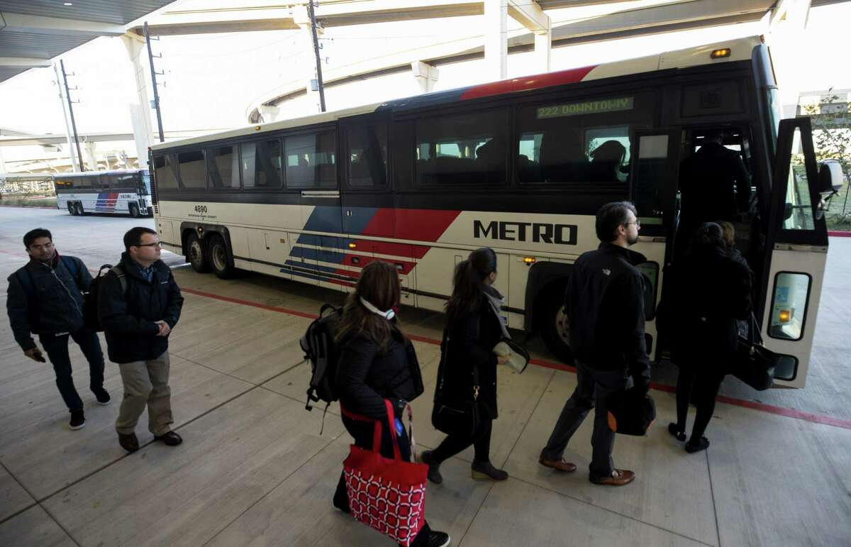 Commuters board a Metropolitan Transit Authority bus heading to downtown Houston at the Grand Parkway Park and Ride on Jan. 4, in Katy. Tying commuters to better local bus service in Houston is a key concept of the planned long-range transit plan.