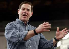FILE - In this June 20, 2018, file photo, Arizona Gov. Doug Ducey, R, speaks at a campaign rally in Tempe, Ariz. Education is shaping up to be the top issue in Arizona's gubernatorial race after anger about stagnating school funding bubbled over into a six-day walkout this spring. Three Democrats and one Republican primary challenger are running to unseat Republican incumbent Gov. Doug Ducey.  (AP Photo/Matt York, file)