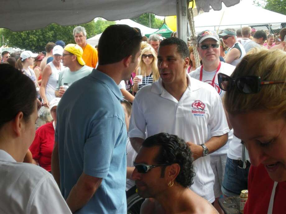 Gov. David Paterson chats with people who ran -- or wheel-chaired -- in the 33rd annual Boilermaker Road Race in Utica on Sunday.  (Jimmy Vielkind / Times Union)