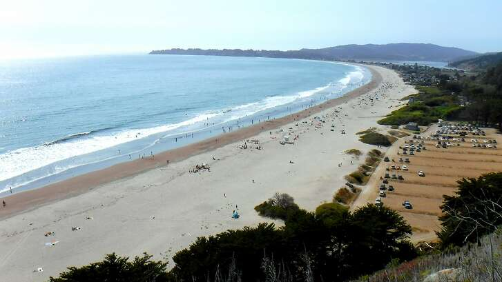 Overlook of Stinson Beach shows miles of beach extending north to mouth of Bolinas Lagoon, plenty of parking