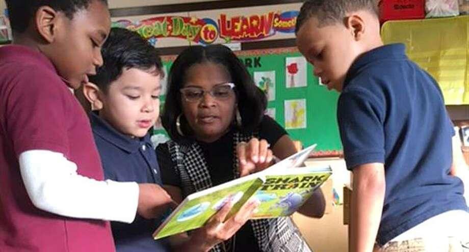 Bridgeport Schools Superintendent Aresta Johnson reading to students Photo: Contributed