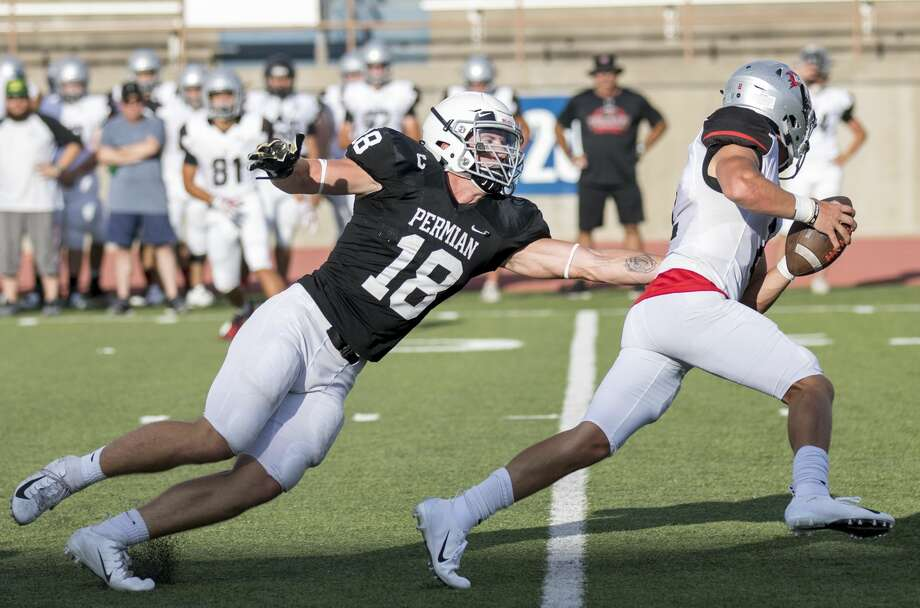Permian's Matt Jones (18) attempts to tackle Lubbock Cooper's Brenden Mehl during a successful scrimmage for the Panthers Friday night at Ratliff Stadium. Photo: Jacy Lewis/191 News