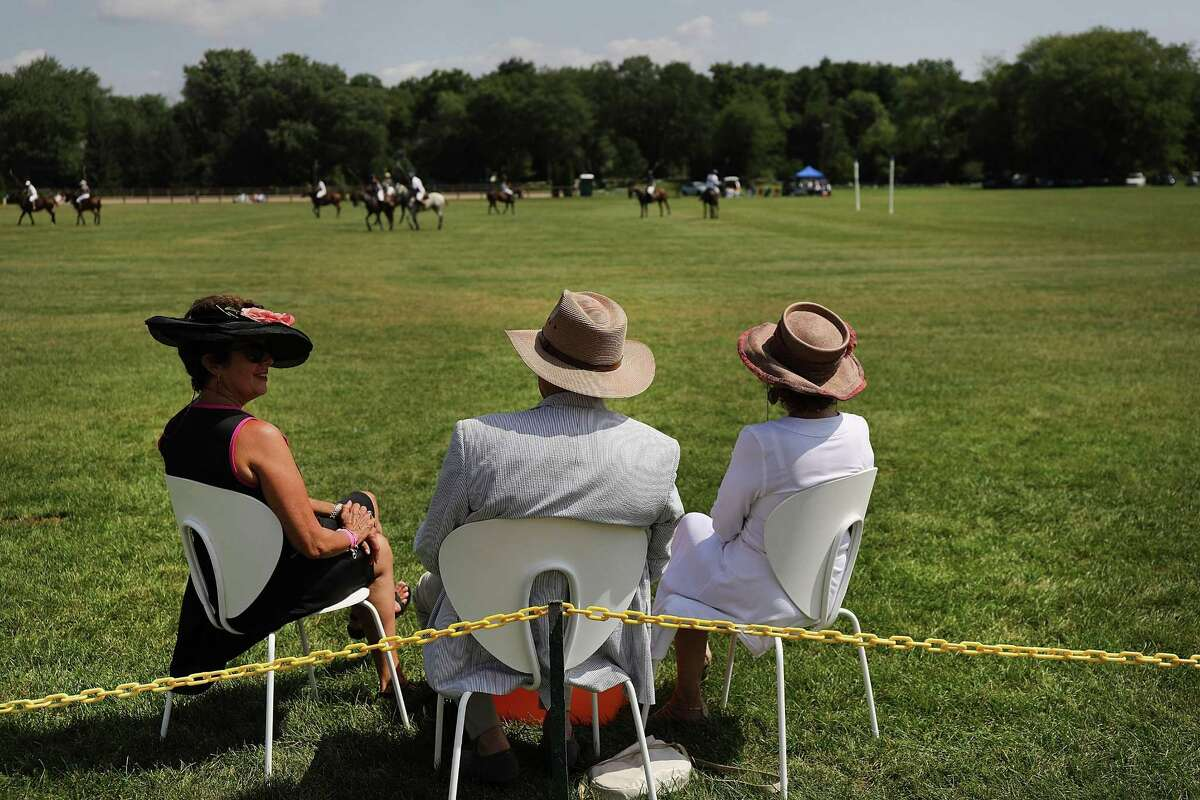 FAIRFIELD, CT - AUGUST 26: Fans watch a the ninth annual Gold's Dragoons Polo Cup at the Fairfield Hunt Club on August 26, 2018 in Westport, Connecticut. The tournament, an end-of-summer tradition for polo fans throughout the area, features a tailgate party, VIP area, a ladies' hat competition and a post-event concert. (Photo by Spencer Platt/Getty Images)