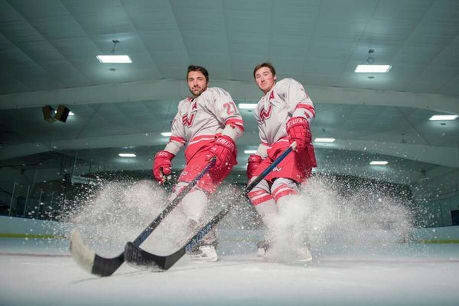 Guy Soulliere, left, and Steven Roberts, members of the SVSU hockey club, have been selected to participate inthe Student Hockey Challenge in Krasnoyarsk, Russia, in September and October.