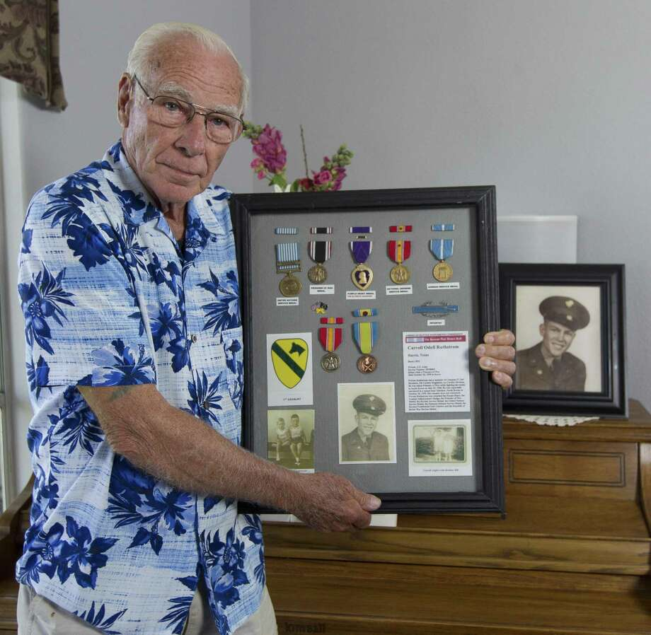 Lester Ruthstrom poses for a portrait with a collection of his brother Army private Carroll's medals and items from his service during the Korean War at his home on Friday, Aug. 3, 2018, in Conroe. Lester, whose brother was reported as missing in action in 1950, will fly to Washington D.C. on Aug. 6 to attend an annual conference for families of Korean MIAs. Photo: Jason Fochtman, Staff Photographer / Staff Photographer / © 2018 Houston Chronicle