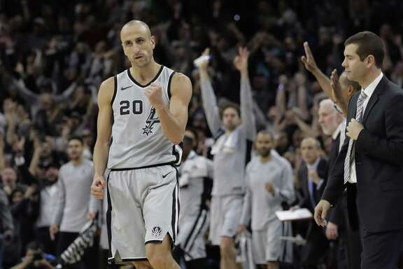 """FILE - In this Dec. 8, 2017, file photo, San Antonio Spurs guard Manu Ginobili (20) pumps his fist after hitting the winning shot in the final seconds of the team's NBA basketball game against the Boston Celtics, in San Antonio. Ginobili retired at age 41 Monday, Aug. 27, 2018, after a """"fabulous journey"""" in which he helped the San Antonio Spurs win four NBA championships in 16 seasons with the club. (AP Photo/Eric Gay, File)"""