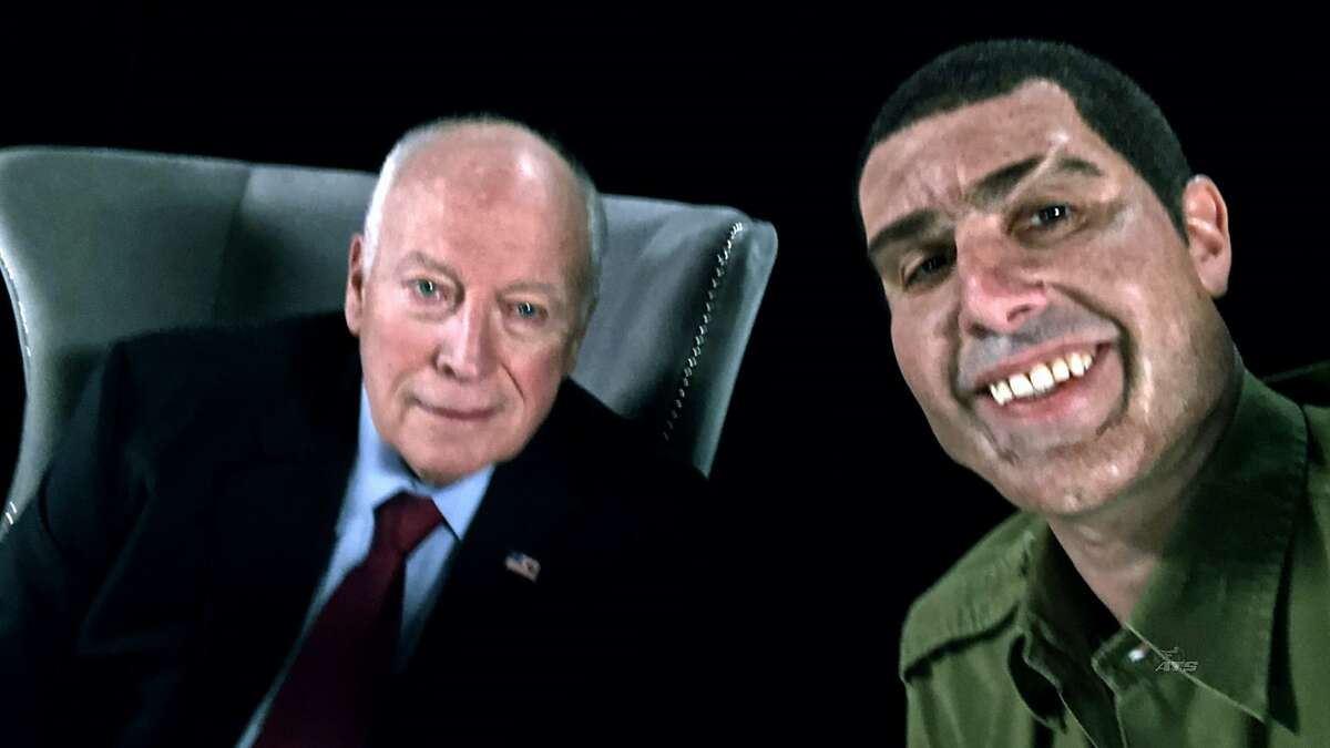 """This image released by Showtime shows former Vice President Dick Cheney, left, and actor Sacha Baron Cohen, portraying retired Israeli Colonel Erran Morad in a still from """"Who Is America?"""" (Showtime via AP)"""